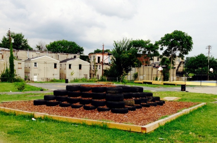 A play area and tire playground made by volunteers. (Photo by Danielle Sweeney)